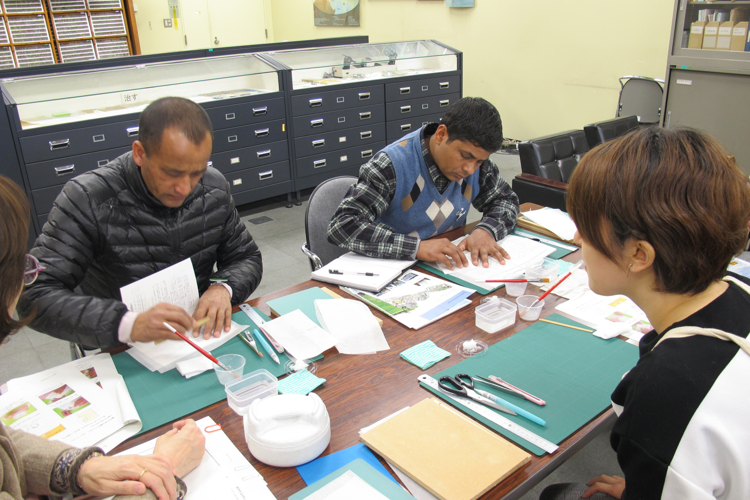 Colleagues from Nepal learn about book repair using washi